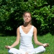 Woman doing yoga meditation — Stock Photo