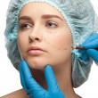 Female face before plastic surgery operation - Stock Photo