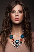 Woman with beautiful necklace — Stok fotoğraf