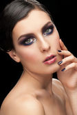 Woman with makeup and manicure — Stock Photo