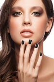 Woman with black manicure — Stock Photo