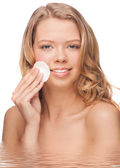 Woman cleaning her face — Stock Photo