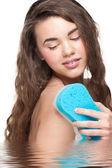 Woman with bath sponge — Stock Photo