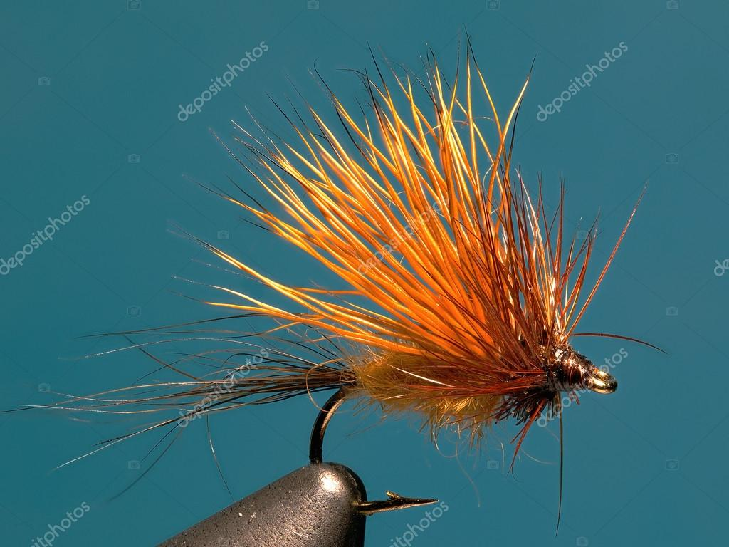 Fly fishing lure for fish to fish made of fur dress and coat proteins, imitation insect on the water surface.  Stock Photo #14338117
