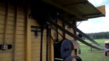 The turning wheels of farm machine — Stockvideo