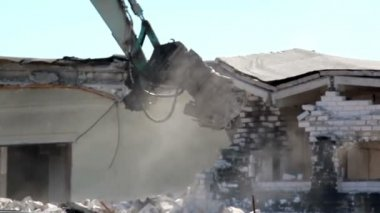 A damaged property has been bulldozed in order to clean the area — Stock Video