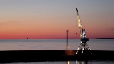 Crane at port during sundown — Stock Video