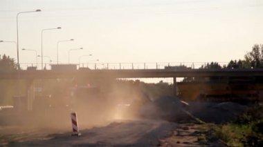 Truck leaving a site full of sand, gravel and soil — Stock Video
