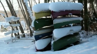 Eight boats turned upside down are covered with snow — Stock Video