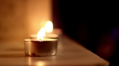 Three candle lights aligned to each other — Vídeo Stock