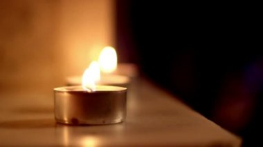 Three candle lights aligned to each other — Vídeo de stock