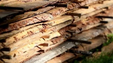 Wood sawmatrial planks piled — Stock Video