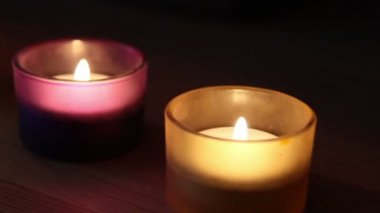 Four candles in the glass with different colors — 图库视频影像