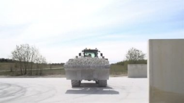 A bulldozer carrying lots of stones — Stock Video