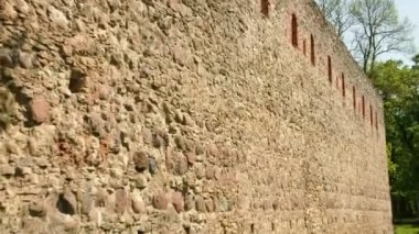The stone wall from an old castle — Stok video
