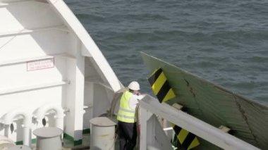 Worker in uniform in boat cargo — Stock Video