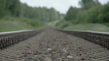 Closer look of the black stones from the train track FS700 Odyssey 7Q — Stock Video