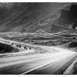 Black and white image of the road — Stock Photo