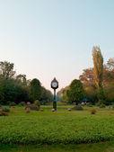 Clock in gardens near the parliament buildings in bucharest romania — Stock Photo