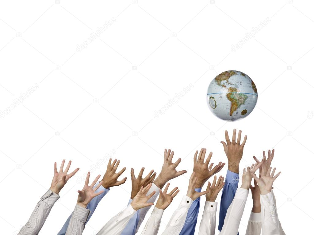 Multi ethnic hands reaching for globe ball — Stock Photo #14617711