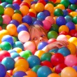 Stock Photo: Girl in balls