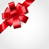 Red bow of ribbon — Stockvector