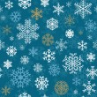 Christmas seamless pattern from snowflakes — Imagen vectorial