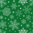 Christmas seamless pattern from snowflakes — Stock Vector