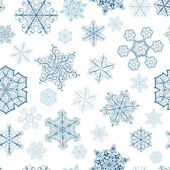 Christmas seamless pattern with big and small snowflakes — Stock Vector