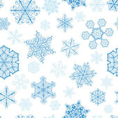 Christmas seamless pattern with big and small snowflakes — 图库矢量图片