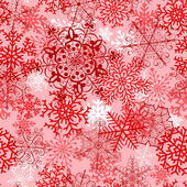 Christmas seamless pattern with red snowflakes — Stockvector