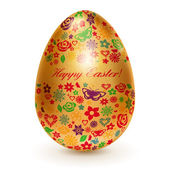 Golden egg with flowers — Stock Vector