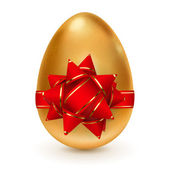 Golden egg with red bow — Stock Vector