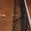 Royalty-Free Stock Photo: Red clay and tennis