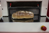 Cutting bread — Stock Photo