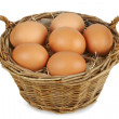Wicker basket with eggs — Stock Photo #14311351
