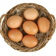 Wicker basket with eggs — Stock Photo