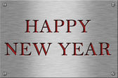 Metal plate with happy new year. — Stock Photo