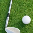 Golf Ball And Club On The Green — Stock Photo