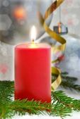 Red shining candel, dark christmas background — Stock Photo