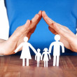 Family with house of hands - Stock Photo