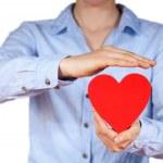 Постер, плакат: Person holding a heart