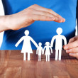Hand protecting family — Stock Photo #24383869