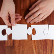 Hands doing a puzzle — Stok fotoğraf