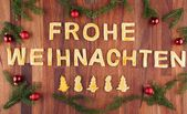 Frohe Weihnachten with decorations — Zdjęcie stockowe