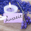 Stock Photo: Purple label with Auszeit on it