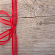 A red bow on wood — Stock Photo