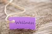 Purple label with wellness — Stock Photo