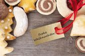 Christmas cookie background with Frohe Weihnachten — Stock Photo