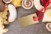 Christmas cookies with golden label — Stock Photo
